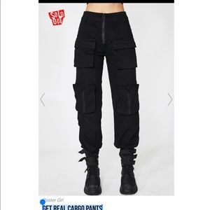 Dolls Kill poster girl GET REAL CARGO PANTS